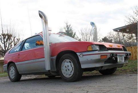 LKW Auspuff an altem Mazda